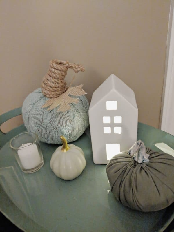 sweater pumpkin display