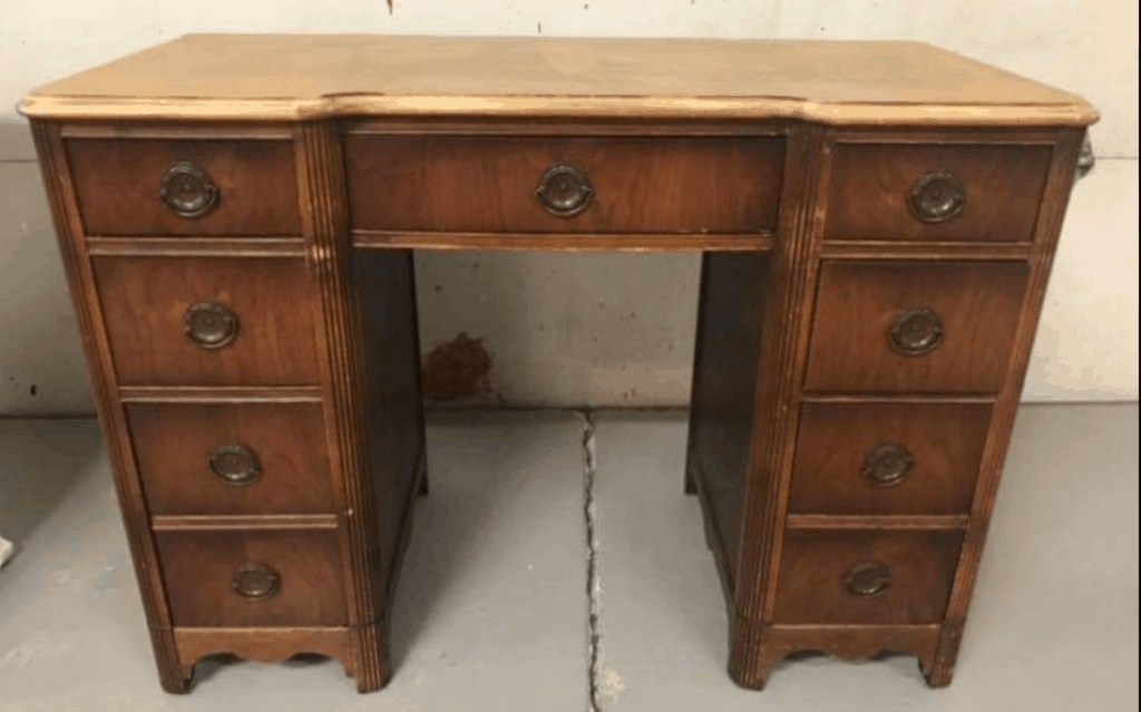 vintage desk with drawers in need of a makeover