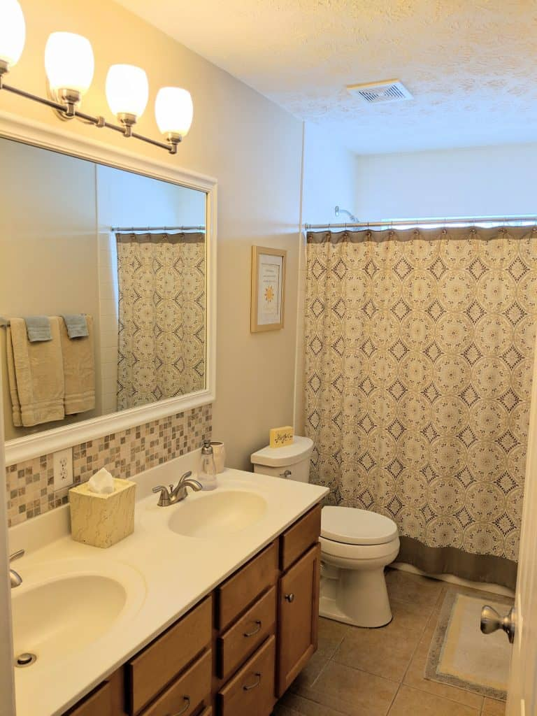 staged guest  bathroom with cohesive look and color scheme